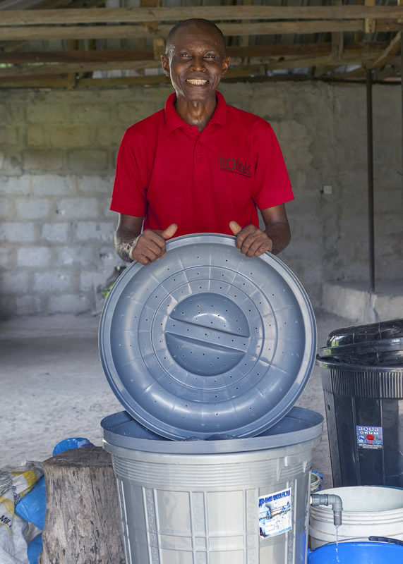 Mr. Henry Erikowa during construction of a Biosand Filter
