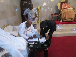 Chief Pessu and Mr. Mike signing the MoU