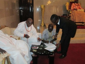 Mr. Henry Erikowa signing the MoU